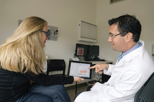 Dr. Ari Green and a colleague demonstrate how doctor and patient would sit side by side as they discuss patient data using the BioScreen app. ©Regents of the University of California — San Francisco.